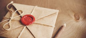 Letter in a craft envelope with a sealing wax seal in the form of a heart