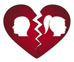 Image of broken heart. Man and woman on each side