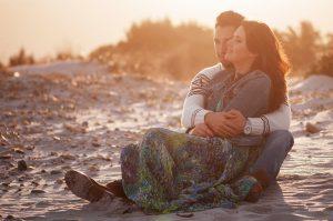 Lovely couple on the sunset beach, selective focus